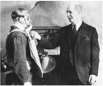 English physicist Sir William Henry Bragg examining liquid oxygen at a 1936 science exhibition.