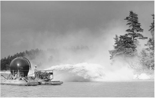 This worker is spraying a lake in Sweden with agricultural lime (calcium oxide), in an attempt to counteract the inflow of acidic materials.