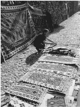 A carpet trader in Sarajevo, Bosnia and Herzegovina. Wool fibers are refined to produce high-quality fabrics for numerous commercial purposes.