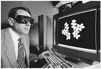 Michael Chaney of Lilly Research Labs wearing 3-D glasses to view a computer model of Fluoxetine, or Prozac. The glasses dim and brighten in response to the flashing of the computer monitor.