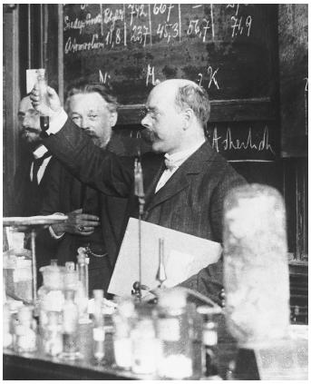 "German chemist and physicist Walther Hermann Nernst (front holding vial), recipient of the 1920 Nobel Prize in chemistry, ""in recognition of his work in thermochemistry."""