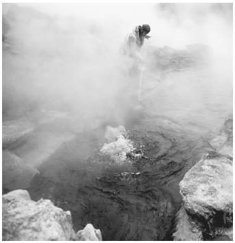 A scientist studying helium being released from a hot spring in Yellowstone National Park.