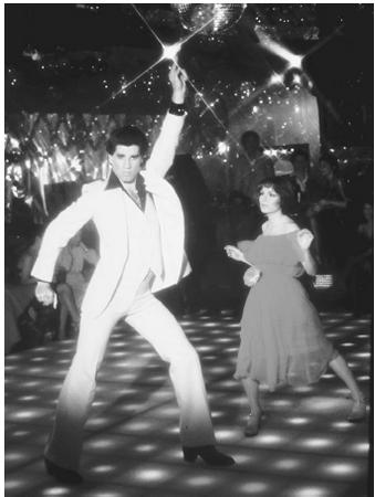 John Travolta and Karen Lynn Gorney in the 1970s hit film Saturday Night Fever. Polyester was a popular fabric used in clothing in the 1970s.