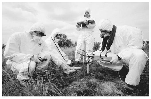 These radiologists are measuring radioactivity levels in the soil near the Chernobyl nuclear plant, Ukraine.