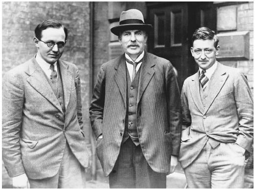"British physicist Ernest Rutherford (middle), recipient of the 1908 Nobel Prize in chemistry, ""for his investigations into the disintegration of the elements, and the chemistry of radioactive substances."""