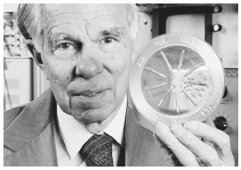 "American chemist Glenn Theodore Seaborg, corecipient with Edwin Mattison McMillan of the 1951 Nobel Prize in chemistry, ""for their discoveries in the chemistry of the transuranium elements."" Here, Seaborg holds a container of samples of the radioactive elements 94 through 102."