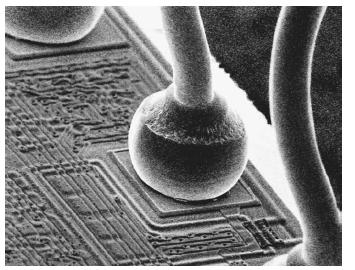 Micro-wires bonded on a silicon chip.